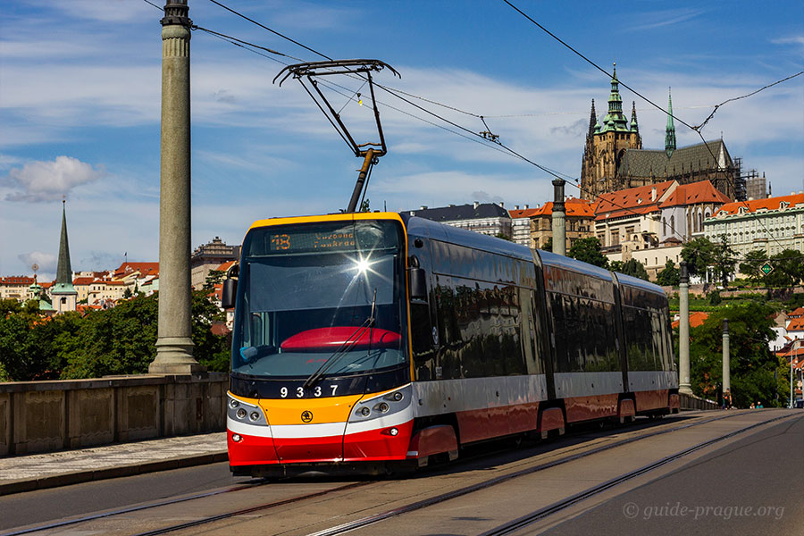 Photo of a tram, Prague Castle on the background