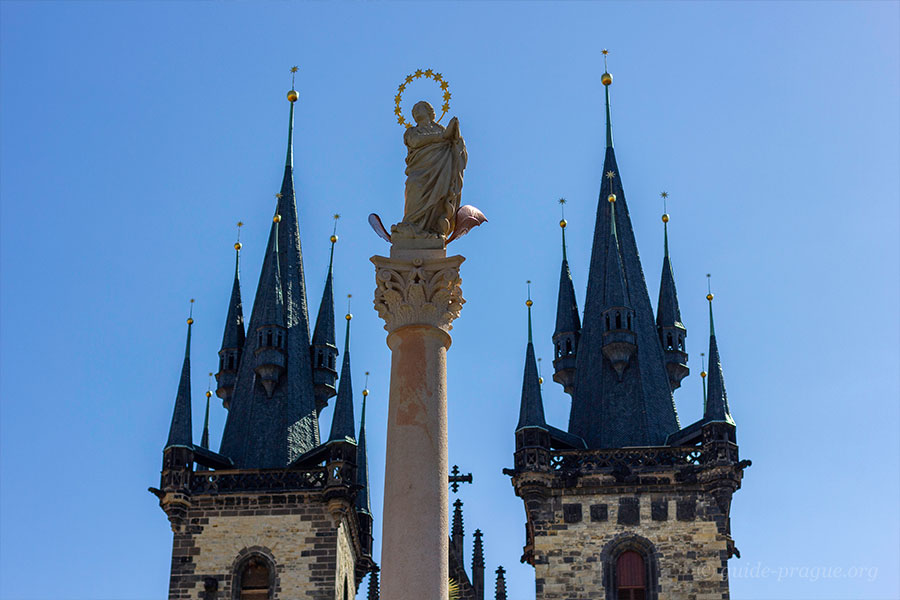 Photo of the column of Virgin Mary and towers of the Church of Our Lady before Tyn, Prague