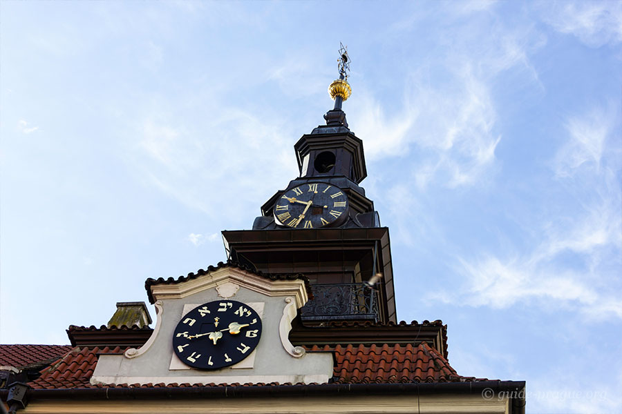 Photo of the clock on the building of Town Hall in the Jewish Quarter, Prague